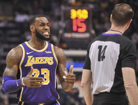 Dec 8, 2018; Memphis, TN, USA; Los Angeles Lakers forward LeBron James (23) talks with referee Ed Malloy (14) during the first half against the Memphis Grizzlies at FedExForum. Mandatory Credit: Justin Ford-USA TODAY Sports