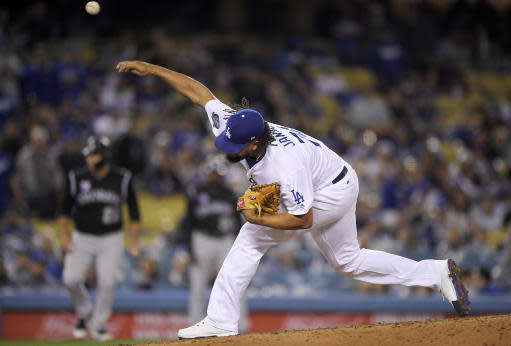 Los Angeles Dodgers relief pitcher Kenley Jansen throws during the ninth inning of the team's baseball game against the Colorado Rockies on Tuesday, May 22, 2018, in Los Angeles. (AP Photo/Mark J. Terrill)