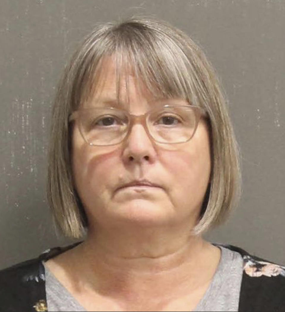This booking photo released by the Metro Nashville, Tenn., Police Department, shows Lisa Marie Eisenhart. A Washington, D.C., judge on Wednesday, Feb. 17, 2021, ordered that a Georgia woman and her Tennessee son remain jailed pending trial on charges for their involvement in the Jan. 6 riot at the U.S. Capitol. Lisa Eisenhart is accused of breaking into the Capitol with her son, Eric Munchel, who was photographed carrying flexible plastic handcuffs in the Senate chamber. (Metro Nashville Police Department via AP)