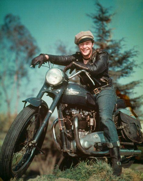 <p>By the 1950s, jeans were seen as more than just Western attire. Marlon Brando sported a darker wash denim for his role in <em>The Wild One</em>, which he paired with a leather jacket and Breton cap. </p>