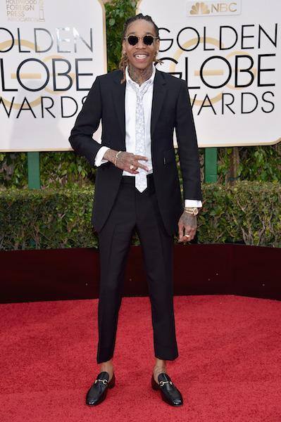 Wiz Khalifa in a black suit and Gucci loafers at the 73rd Golden Globe Awards.