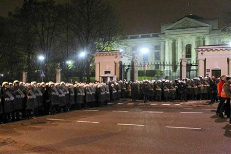 Riot police form cordon in front of Russian embassy during far-right march in Warsaw