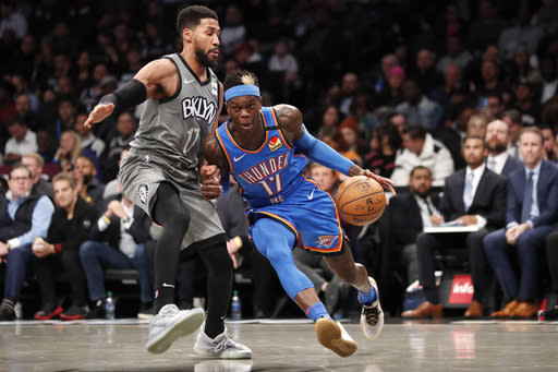 Oklahoma City Thunder forward Darius Bazley (7) drives up against Brooklyn Nets guard Garrett Temple (17) during the first half of an NBA basketball game, Tuesday, Jan. 7, 2020, in New York. (AP Photo/Kathy Willens)