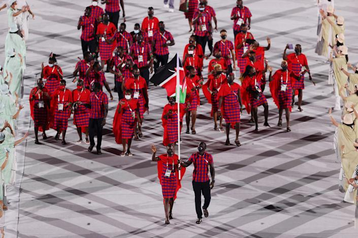 <p>TOKYO, JAPAN - JULY 23: Flag bearers Mercy Moim and Andrew Amonde of Team Kenya during the Opening Ceremony of the Tokyo 2020 Olympic Games at Olympic Stadium on July 23, 2021 in Tokyo, Japan. (Photo by Clive Brunskill/Getty Images)</p>