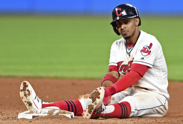 <p> Cleveland Indians' Francisco Lindor sits near second base after being forced out in a double play in the seventh inning of a baseball game against the Kansas City Royals, Friday, Sept. 15, 2017, in Cleveland. (AP Photo/David Dermer) </p>