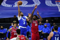 Los Angeles Lakers' Anthony Davis (3) goes up for a shot against Philadelphia 76ers' Joel Embiid (21) during the first half of an NBA basketball game, Wednesday, Jan. 27, 2021, in Philadelphia. (AP Photo/Matt Slocum)