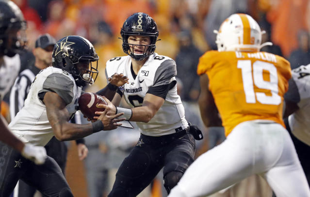 Vanderbilt quarterback Riley Neal (6) hands the ball off to running back Ke'Shawn Vaughn (5) in the first half of an NCAA college football game against Tennessee Saturday, Nov. 30, 2019, in Knoxville, Tenn. (AP Photo/Wade Payne)
