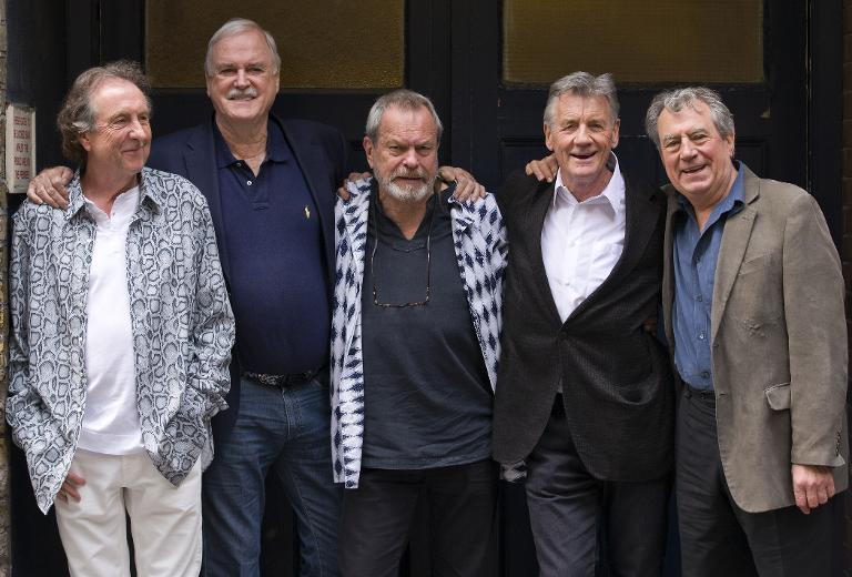 British comedy troupe Monty Python, (L-R) Eric Idle, John Cleese, Terry Gilliam, Michael Palin, and Terry Jones pose for a photograph at the back door to the London Palladium in central London on June 30, 2014