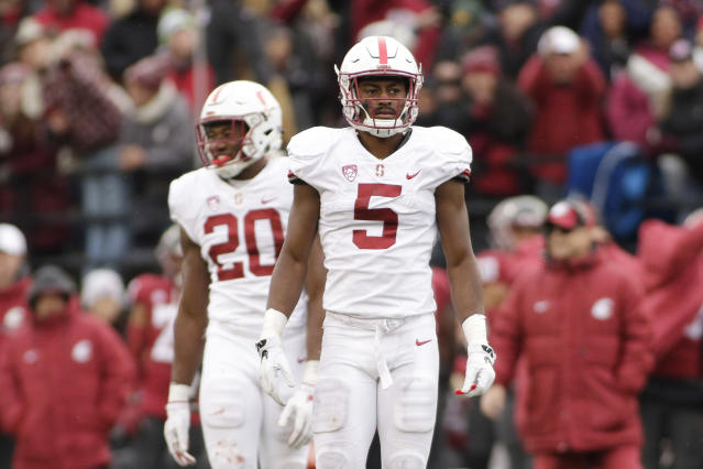 Stanford safety Frank Buncom (5) and linebacker Bobby Okereke (20) walk on the field during the second half of an NCAA college football game against Washington State in Pullman, Wash., Saturday, Nov. 4, 2017. (AP Photo/Young Kwak)