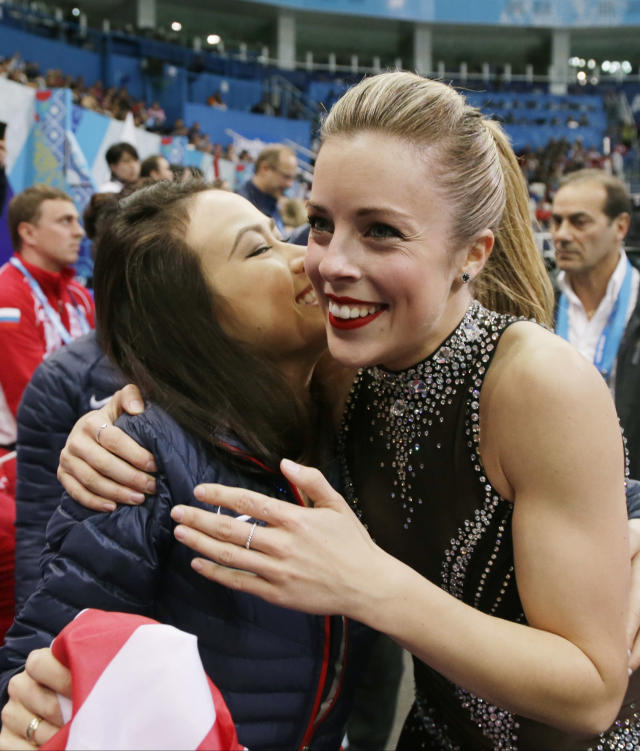 Ashley Wagner of the United States, right, is embraced by a team mate after competing in the women's team short program figure skating competition at the Iceberg Skating Palace during the 2014 Winter Olympics, Saturday, Feb. 8, 2014, in Sochi, Russia. (AP Photo/Darron Cummings, Pool)
