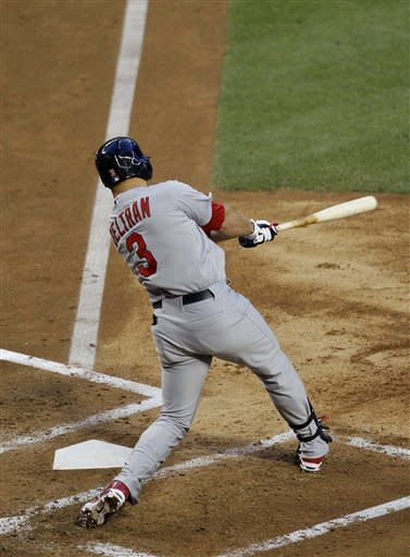 St. Louis Cardinals' Carlos Beltran follows through on his grand slam against the Arizona Diamondbacks during the second inning of a baseball game Tuesday, May 8, 2012, in Phoenix. (AP Photo/Matt York)