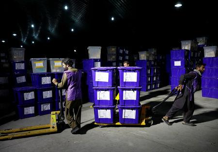 Afghan election commission workers prepare ballot boxes and election material to send to the polling stations at a warehouse in Kabul, Afghanistan October 18, 2018.REUTERS/Mohammad Ismail