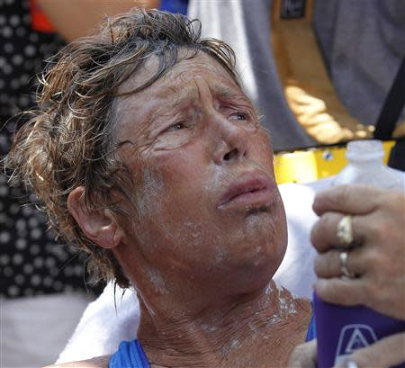 U.S. long-distance swimmer Diana Nyad reacts to a question, while lying on a stretcher, after completing her swim from Cuba to Key West