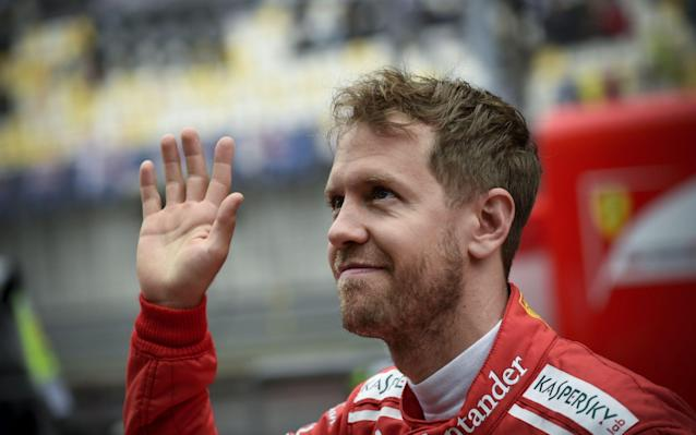 <span>Sebastian Vettel waves to fans following the cancelled practice session at the Chinese Grand Prix</span> <span>Credit: AFP </span>