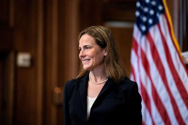 PHOTO: Judge Amy Coney Barrett, President Donald Trump's Nominee for Supreme Court, poses for a photo before a meeting with Senator Roy Blunt on Capitol Hill in Washington DC, Oct. 21, 2020. (Anna Moneymaker/Pool via Reuters, FILE)