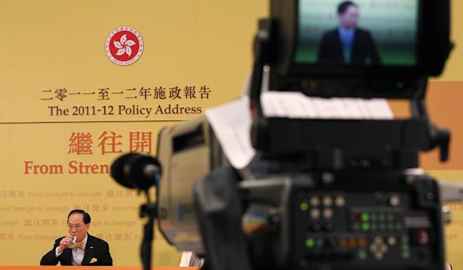Then chief executive Donald Tsang attends a television panel discussion of his policy address in October of 2011. Photo: May Tse