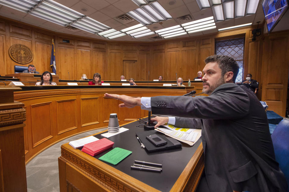 Louisiana House of Representatives Republican Delegation chairman Blake Miguez, R-Erath, speaks in the House and Governmental Affairs committee explaining his House Concurrent Resolution 58, Wednesday, May 6, 2020, at the state Capitol in Baton Rouge, La. Republican lawmakers trying to unravel Louisiana Gov. John Bel Edwards' statewide stay-at-home order began moving legislation Wednesday that would keep the Democratic governor from enforcing the restrictions enacted to combat the coronavirus. (Travis Spradling/The Advocate via AP)