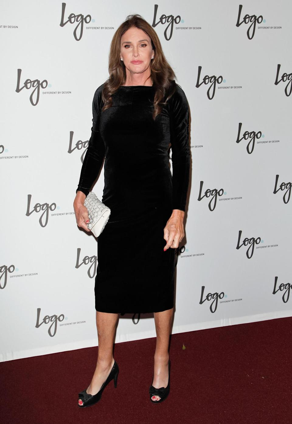 <p>For her birthday on October 28, Caitlyn Jenner celebrated the night before by walking a red carpet in a black velvet dress. She paired the long-sleeved piece with open-toe heels, showing off her bright pink pedicure, a white clutch, and diamond earrings. Chandi Moore, Candis Cayne, and Geena Rocero were all in attendance as well. </p>