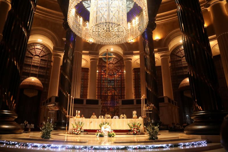 Franck Allatin, priest and rector of the Basilica Notre Dame leads a Christmas mass in Yamoussoukro