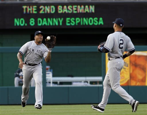 New York Yankees left fielder Andruw Jones, left, catches a fly ball hit by Washington Nationals' Danny Espinosa, as shortstop Derek Jeter watches during the second inning of a baseball game at Nationals Park on Friday, June 15, 2012, in Washington. (AP Photo/Alex Brandon)