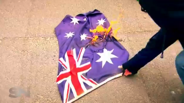 At a rally attended by Sunday Night the Australian flag was set alight