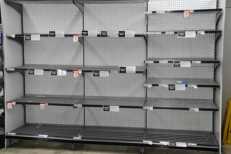 Empty shelves of tissues are seen at Woolworths as shopper continue to panic buy in fear of a coronavirus lock down