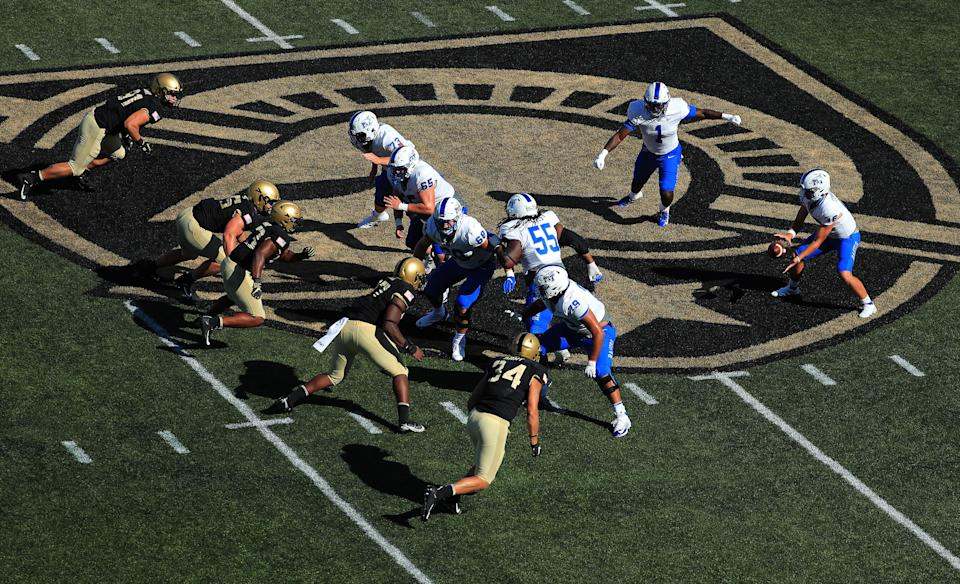 Chase Cunningham takes a snap against Army.