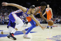 Oklahoma City Thunder's Shai Gilgeous-Alexander, right, and Philadelphia 76ers' Ben Simmons chase down a loose ball during the first half of an NBA basketball game, Monday, Jan. 6, 2020, in Philadelphia. (AP Photo/Matt Slocum)