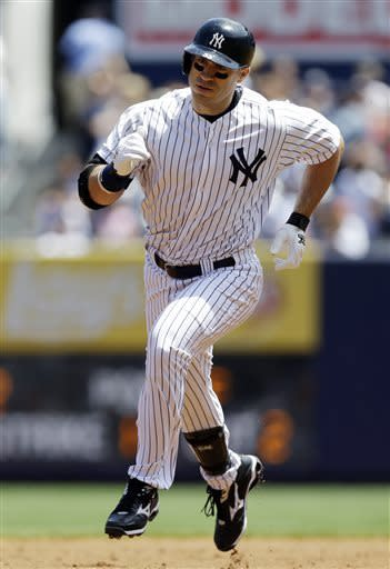 New York Yankees designated hitter Travis Hafner (33) rounds the bases after hitting a two-run home run off Cleveland Indians starting pitcher Corey Kluber in the first inning of a baseball game at Yankee Stadium in New York, Wednesday, June 5, 2013. (AP Photo/Kathy Willens)