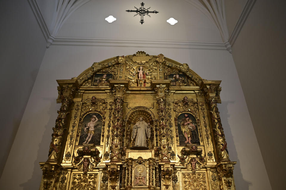 An altarpiece shows religious figures inside the second oldest Spanish church in the Americas, the San Jose Church, that will reopen following a massive reconstruction that took nearly two decades to complete in San Juan, Puerto Rico, Tuesday, March 9, 2021. All the figures depicted on the church's gilded altar have been identified except for one: a woman with flaxen hair in the upper left-hand corner holding a palm frond, which indicates she was a martyr but offers no other clues. (AP Photo/Carlos Giusti)