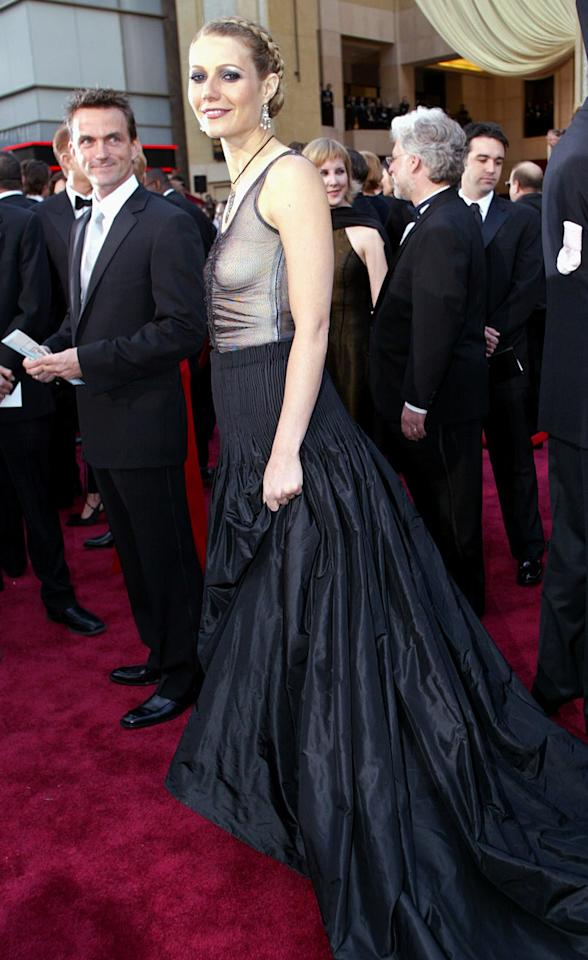 <p>Presenter Paltrow raised a few eyebrows in her sheer-top Alexander McQueen goth-style gown. (Photo: Doug Mills/AP) </p>