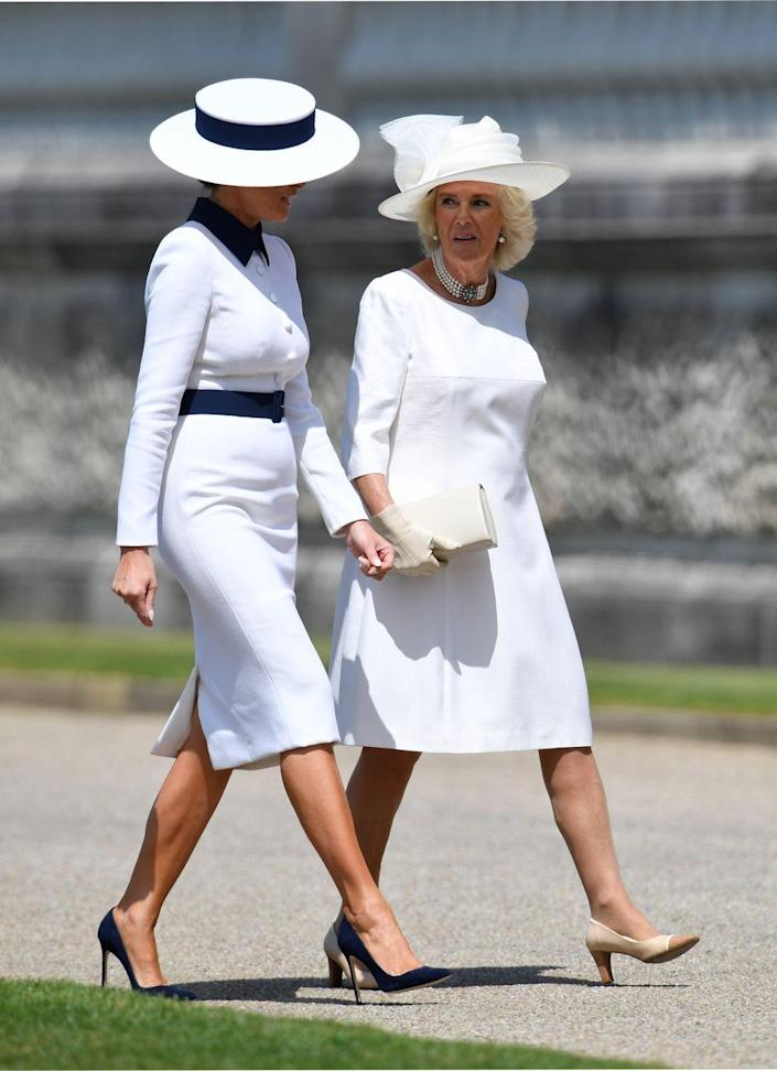 <p>The Duchess of Cornwall greets Melania Trump at Buckingham Palace for an official welcome. Both women are wearing shades of white and hats for the occasion.</p>