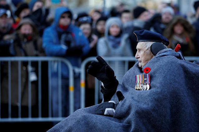 <p>A veteran waves to the crowd as he arrives for Remembrance Day ceremonies at the National War Memorial in Ottawa, Ontario, Canada, Nov. 11, 2017. (Photo: Chris Wattie/Reuters) </p>
