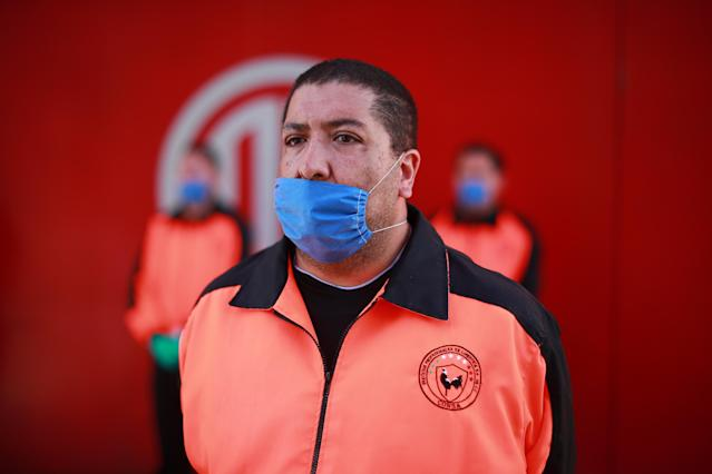 Security personnel wear medical face masks before the 10th round match between Toluca and Atlas as part of the Torneo Clausura 2020 Liga MX at Nemesio Diez Stadium on March 15, 2020 in Toluca, Mexico. The match is played behind closed doors to prevent the spread of the novel Coronavirus (COVID-19). (Photo by Hector Vivas/Getty Images)
