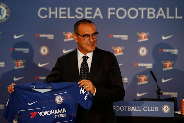 Soccer Football - Premier League - Chelsea present new manager Maurizio Sarri - Stamford Bridge, London, Britain - July 18, 2018 New Chelsea manager Maurizio Sarri poses with the club shirt during the press conference Action Images via Reuters/John Sibley