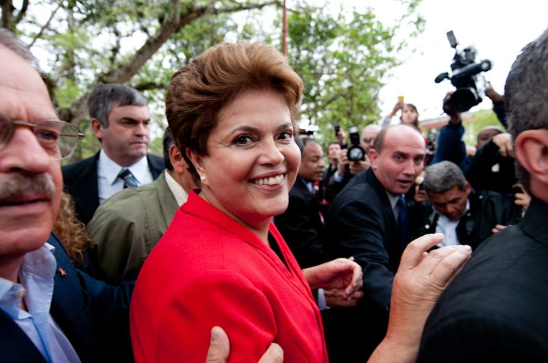 Dilma Rousseff, presidential candidate for the Workers Party,  arrives at a polling station before voting during Brazil's general elections in Porto Alegre, Brazil, Sunday, Oct. 3, 2010. Brazilians vote Sunday in national elections that could see front-running candidate Dilma Rousseff become the country's first female president, succeeding her popular ally and mentor. (AP Photo/Tarlis Schneider/Agencia Freelancer)