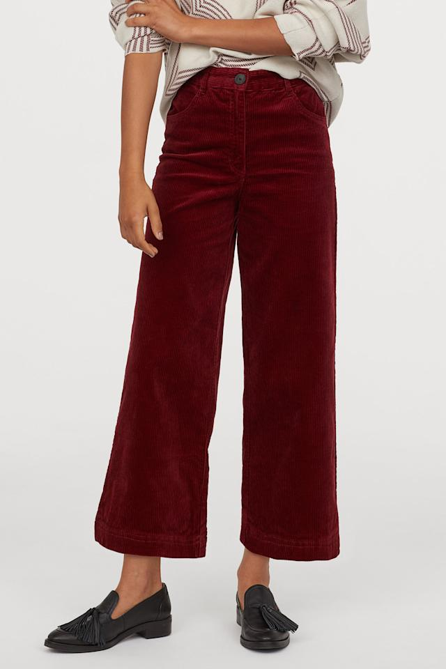 """<p>These <a href=""""https://www.popsugar.com/buy/HampM-Cotton-Corduroy-Pants-489160?p_name=H%26amp%3BM%20Cotton%20Corduroy%20Pants&retailer=www2.hm.com&pid=489160&price=35&evar1=fab%3Aus&evar9=46395601&evar98=https%3A%2F%2Fwww.popsugar.com%2Ffashion%2Fphoto-gallery%2F46395601%2Fimage%2F46597305%2FHM-Cotton-Corduroy-Pants&list1=shopping%2Ch%26m%2Cfall%20fashion%2Caffordable%20shopping&prop13=mobile&pdata=1"""" rel=""""nofollow"""" data-shoppable-link=""""1"""" target=""""_blank"""" class=""""ga-track"""" data-ga-category=""""Related"""" data-ga-label=""""https://www2.hm.com/en_us/productpage.0778051001.html"""" data-ga-action=""""In-Line Links"""">H&amp;M Cotton Corduroy Pants</a> ($35) come in three colors.</p>"""