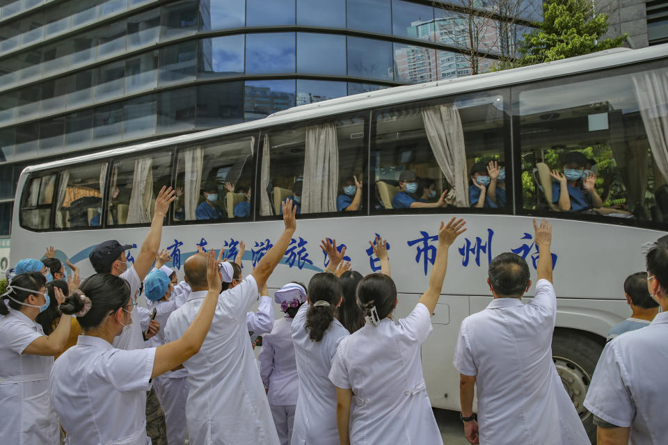 Medical workers send off their colleagues leaving to help with an outbreak of COVID-19 in Putian from a provincial hospital in Fuzhou in southeast China's Fujian province Sunday, Sept. 12, 2021. Putian, a city in southern China that is trying to contain a coronavirus outbreak told the public Sunday not to leave, suspended bus and train service and closed cinemas, bars and other facilities. (Chinatopix via AP)