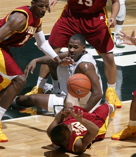 Tuskegee's Camden Foster, bottom, Michigan State's Derrick Nix, center, and Tuskegee's Jacob Pettway vie for the loose ball during the first half of an NCAA college basketball game, Saturday, Dec. 15, 2012, at Jenison Field House in East Lansing, Mich. (AP Photo/Al Goldis)