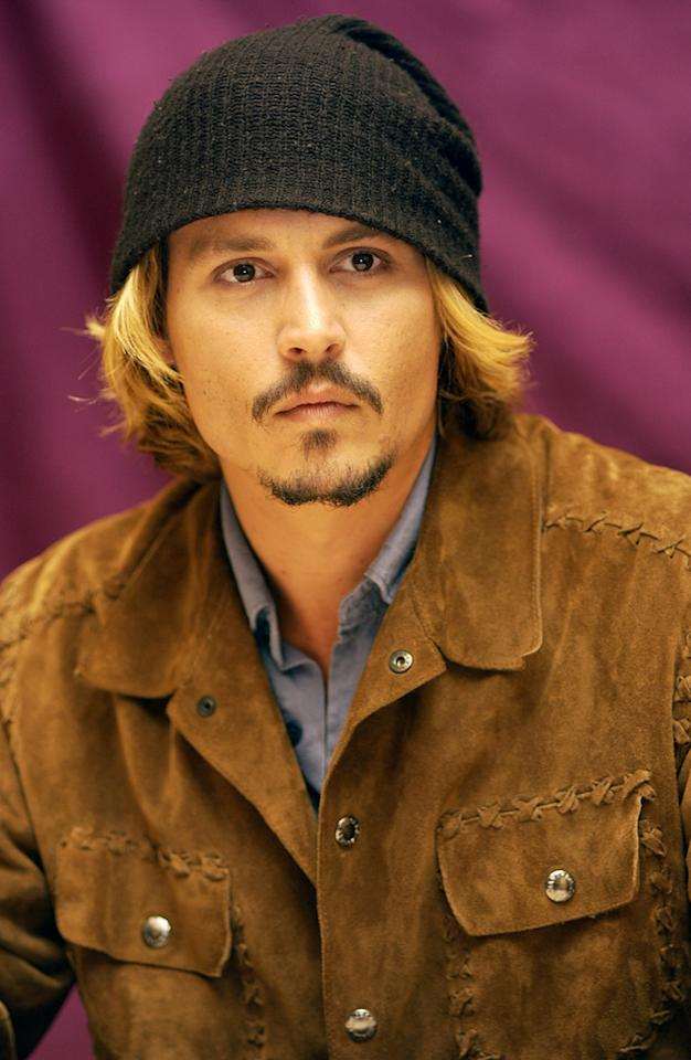Johnny Depp reportedly has 13 tattoos and apparently a large collection of stocking caps.