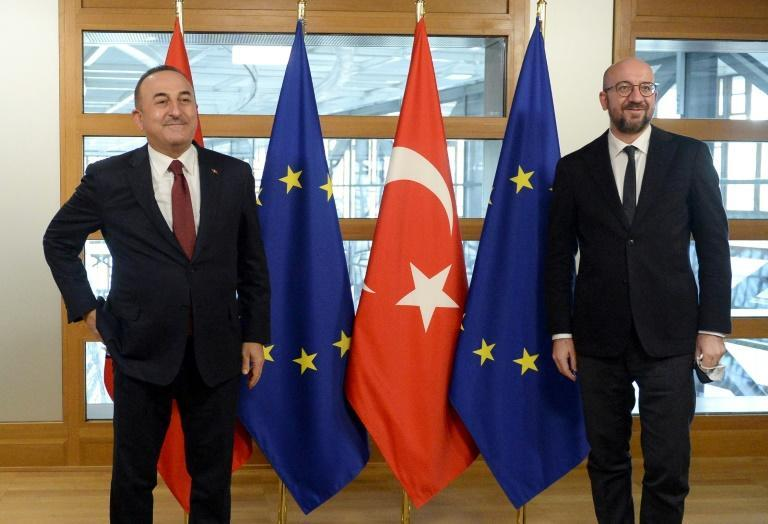 Turkish Foreign Minister Mevlut Cavusoglu (L) is welcomed by European Council President Charles Michel before their meeting in Brussels on Friday. Turkey's EU accession talks have been stalled for years