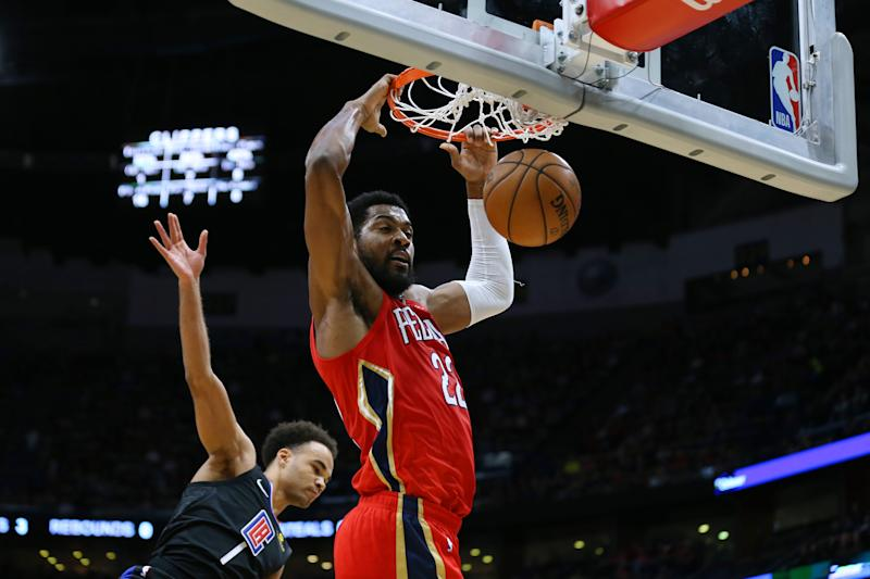 NEW ORLEANS, LOUISIANA - JANUARY 18: Derrick Favors #22 of the New Orleans Pelicans dunks as Jerome Robinson #1 of the LA Clippers defends during a game at the Smoothie King Center on January 18, 2020 in New Orleans, Louisiana. NOTE TO USER: User expressly acknowledges and agrees that, by downloading and or using this Photograph, user is consenting to the terms and conditions of the Getty Images License Agreement. (Photo by Jonathan Bachman/Getty Images)