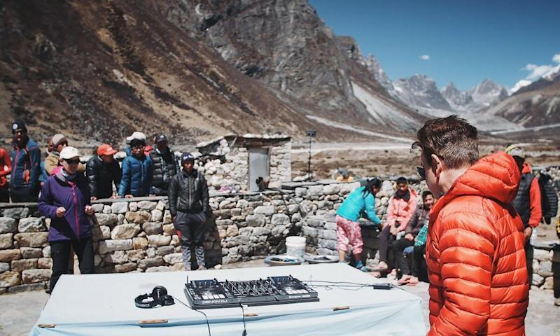 Paul Oakenfold performs a practice set at Pheriche village on his way to Mount Everest's base camp.