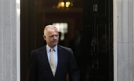 Britain's Foreign Secretary Hague leaves 10 Downing Street in London