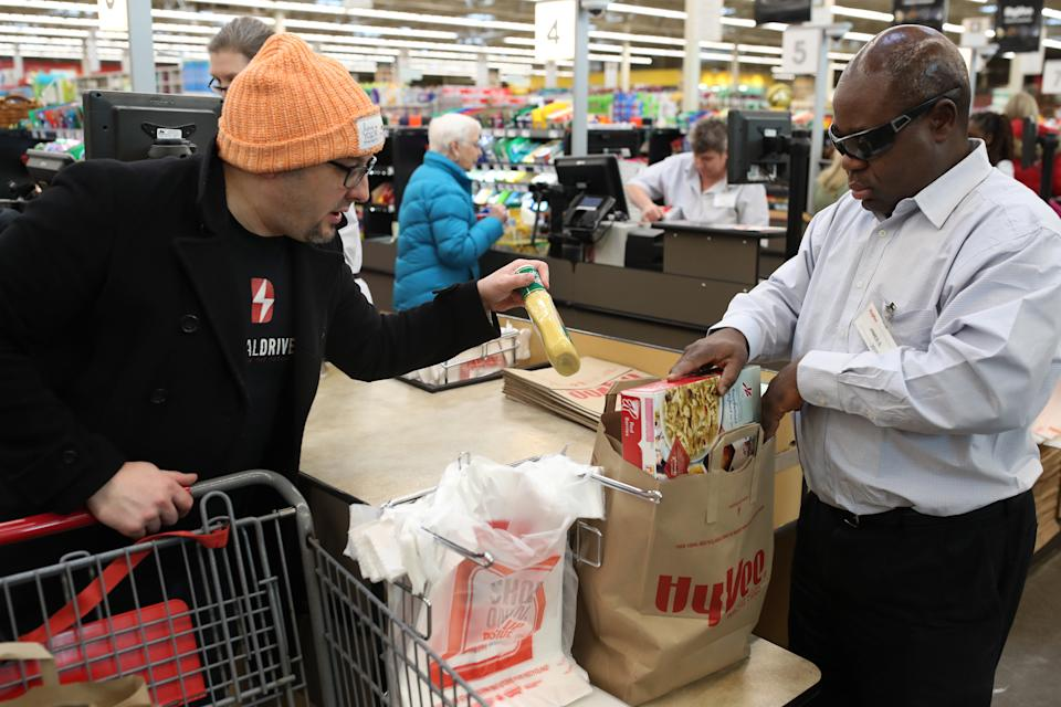 James Sloan an employee at Hy-Vee bagged grocery for a customer Scott Ware Thursday Feb 22 2018 in New Hope, MN.]  Sloan is blind and has been an employee at the store since 2015 JERRY HOLT • jerry.holt@startribune.com (Photo By Jerry Holt/Star Tribune via Getty Images)