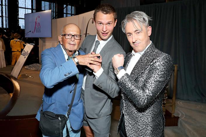 <p>Arthur Elgort and son Ansel Elgort pose with Alan Cumming at The Daily Front Row 8th Annual Fashion Media Awards on Sept. 9 in N.Y.C. </p>