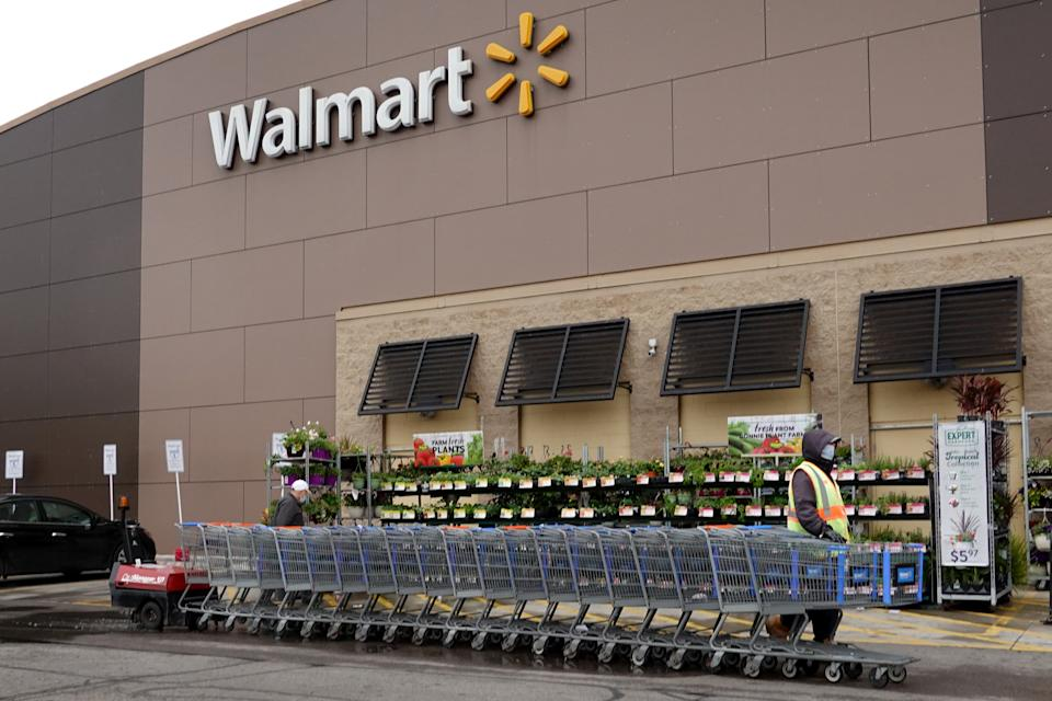 CHICAGO, ILLINOIS - MAY 19: A worker collects shopping carts at a Walmart store on May 19, 2020 in Chicago, Illinois. Walmart reported a 74% increase in U.S. online sales for the quarter that ended April 30, and a 10% increase in same store sales for the same period as the effects of the coronavirus helped to boost sales. (Photo by Scott Olson/Getty Images)