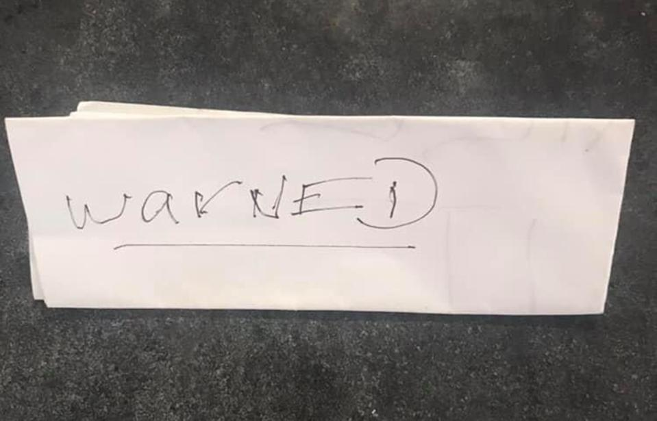 Maryborough mum Tracey Spoor found this 'warning' note a day before her dog was believed to have been baited.