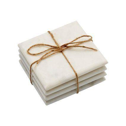 """These white marble coasters look far more expensive than they actually are, and make the perfect gift for that friend who loves to throw dinner parties. <a href=""""https://www.chapters.indigo.ca/en-ca/house-and-home/white-marble-coasters-square-set/090125978742-item.html"""" target=""""_blank"""">Get it here. </a>"""