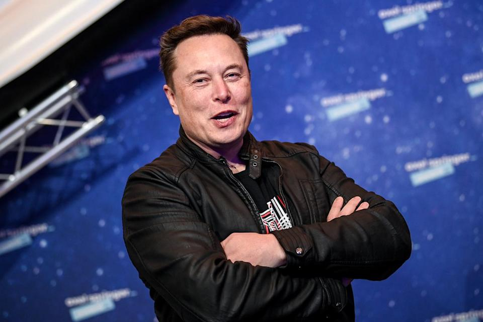 Tesla and SpaceX CEO Elon Musk smiles and folds his arms